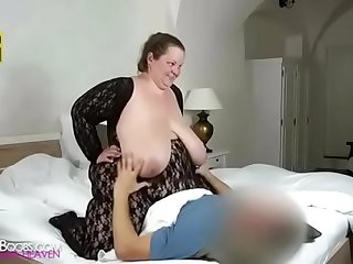Huge boobs Gran plays with..