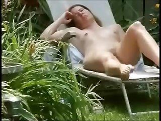 My mom sun bathing and..