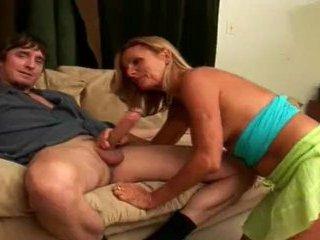 Mature woman sucking off guy