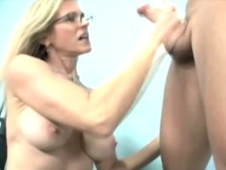Mature blonde is jacking off..