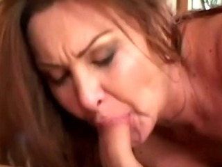 a hot mature brunette sucking